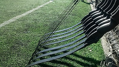 Image of takedown recurve bows leaning against a fence.